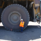 EHS student, Rhonda Turner, stands beside a monster digger during her 2012 inter