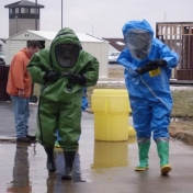 EHS Interns in Level A Personal Protective Equipment