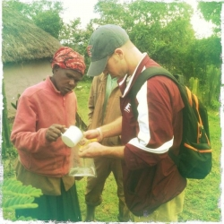 Dr. Marion taking a water sample from a resident in Kenya
